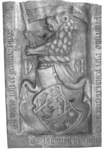 Aatelissuvun kivinen vaakuna. Leijona on sekä kilvessä että kypäränkoristeena.